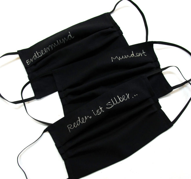 mund-nasenmaske in schwarz bestickt